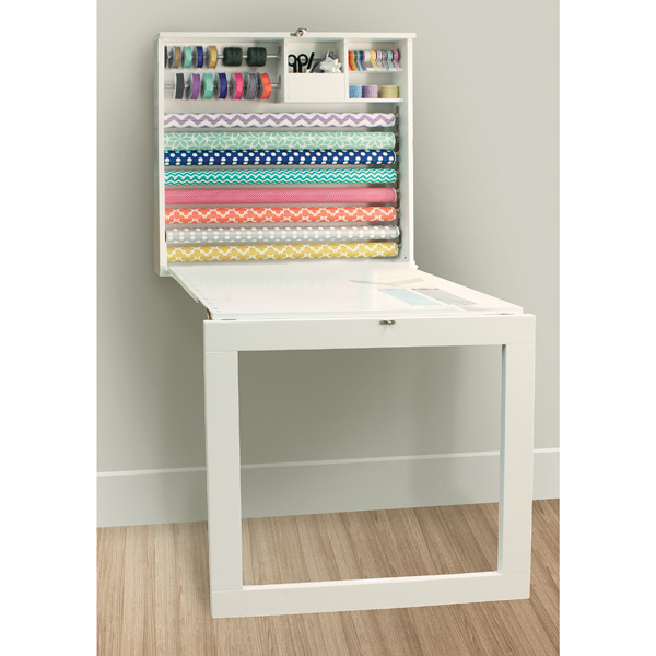 the fold down table top includes a gift wrap size chart and silk screened onto the tabletop for accurate paper cutting