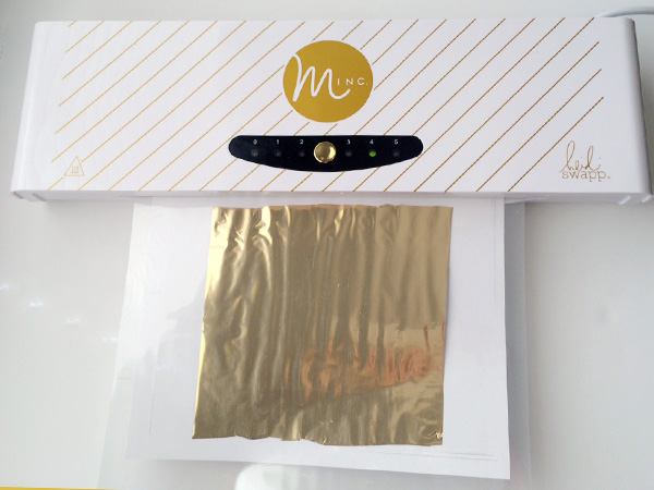 minc machine with DIY gold foil print in heat sleeve