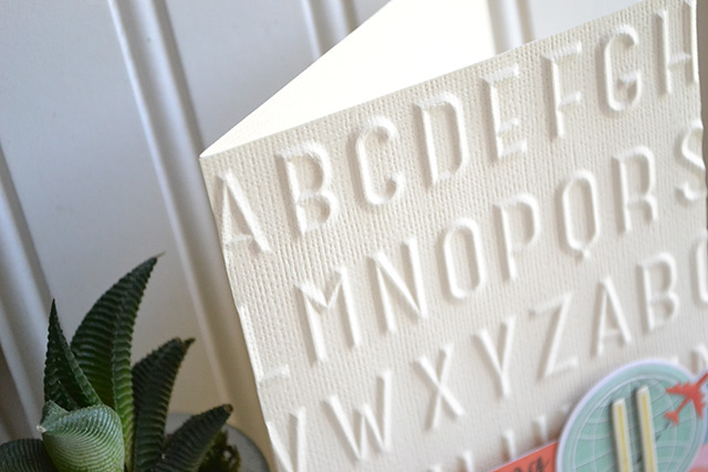 embossed travel card close up by aly dosdall