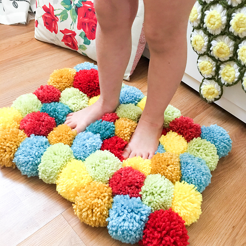 tessa s favorite colors aqua yellow red and green pom pom rug we r memory keepers blog. Black Bedroom Furniture Sets. Home Design Ideas