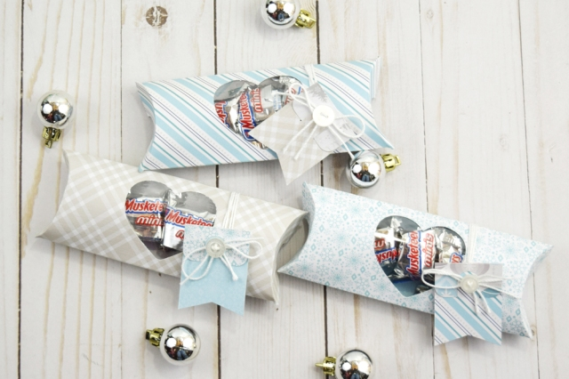 Holiday Pillow Boxes by Becki Adams featuring the We R Memory Keepers Pillow Box Punch Board and the DCWV Winter Frost Premium Stack