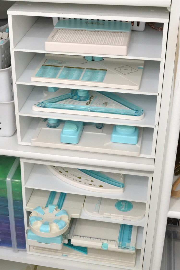 Storage larger punch boards in paper storage cubicles. Featured in Aly Dosdall's craft room.