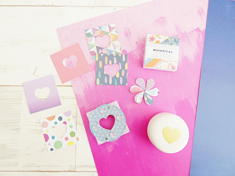 Make DIY scrapbook page embellishments with the We R Memory Keepers 1 Inch Clear Cut Heart Punch